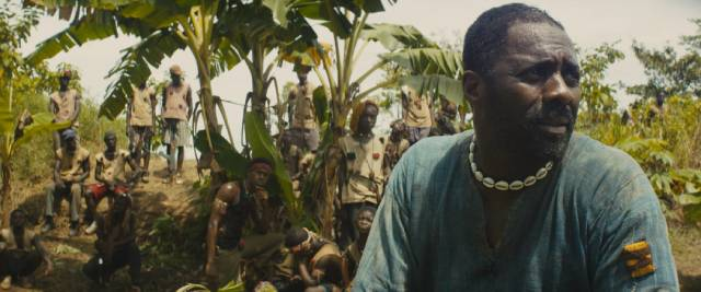 The Commandant (Idris Elba) promises his followers that they will soon have power and wealth in Cary Joji Fukunaga's Beasts of No Nation (2015)