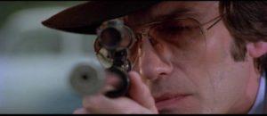 The Black Angel (Ivan Rassimov) launches a nihilistic attack on society in Massimo Dallamano's Colt 38 Special Squad (1976)