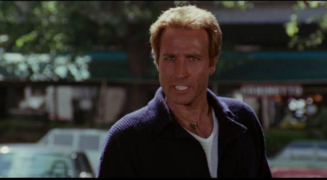 Marco Palma (Maurizio Merli) envies the bad guys' powerful cars in Stelvio Massi's Highway Racer (1977)