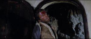 Tom Corbett (Franco Nero) is viciously beaten by Junior Scott (Nino Castelnuovo) in Lucio Fulci's Massacre Time (1966)