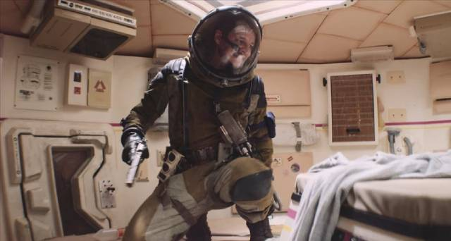 Ezra (Pedro Pascal) follows Cee (Sophie Thatcher) back to the crippled landing ship in Chris Caldwell and Zeek Earl's Prospect (2018)