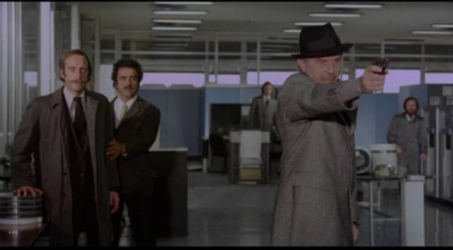 Commissario Santaga (Enrico Maria Salerno) ends a crime spree in Vittorio Salerno's Savage Three (1975)