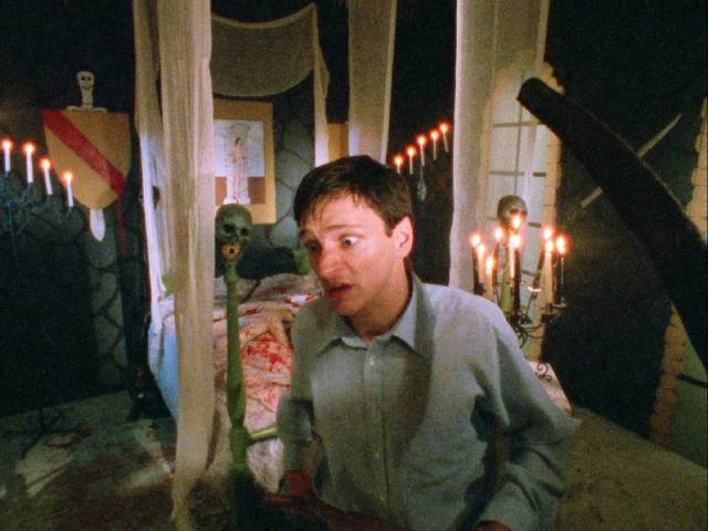 Warren (John Hawkes) has trouble distinguishing real blood from fake gore in Daniel Erickson's Scary Movie (1991)