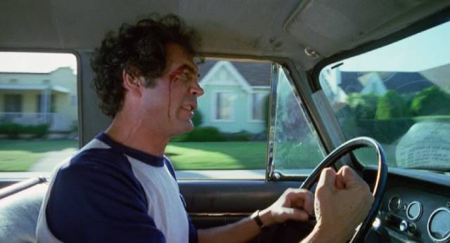 Robert Forster as a cab driver and small-time numbers runner is caught in the woman (Nancy Kwan)'s deadly plans in Norbert Meisel's Walking the Edge (1983)