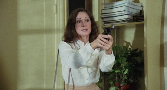 The woman (Nancy Kwan) strikes back at the people who killed her family in Norbert Meisel's Walking the Edge (1983)