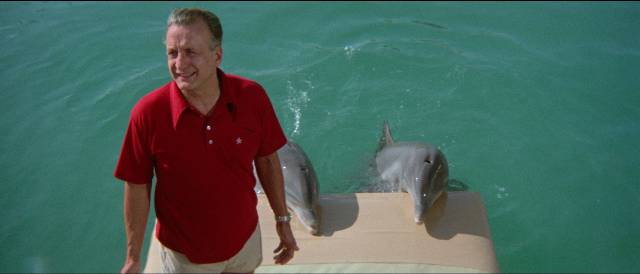 Jake Terrell (George C. Scott) introduces his friends in Mike Nichols' The Day of the Dolphin (1973)