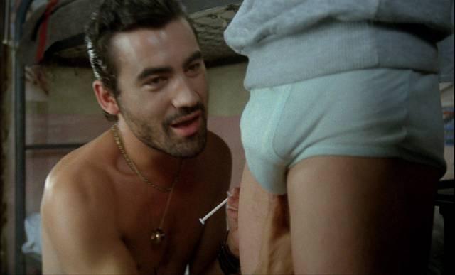 El Lehendaktari (Jaime Valls) offers Paco (Jose Luis Manzano) protection and drugs in Eloy de la Iglesia's El Pico 2 (1984)