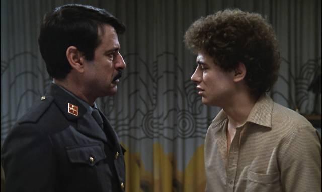 Commander Evaristo Torrecuadrada (Jose Manuel Cervino) discovers that his son Paco (Jose Luis Manzano) is a drug addict in Eloy de la Iglesia's El Pico (1983)