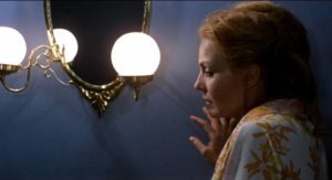 Elisa (Carmen Sevilla) has just seen her neighbour dispose of his wife's body in Eloy de la Iglesia's No One Heard the Scream (1973)
