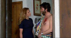 Mutual attraction after Elisa (Carmen Sevilla) tries to kill Miguel (Vicente Parra)in Eloy de la Iglesia's No One Heard the Scream (1973)