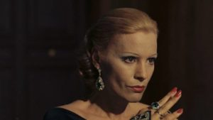 Baroness Sophie (Ingrid Thulin) schemes with her lover to take control of the family business in Luchino Visconti's The Damned (1969)