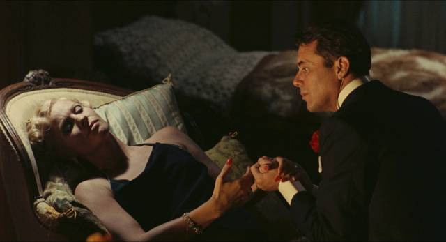 Baroness Sophie (Ingrid Thulin) and Friedrich (Dirk Bogarde) plot their takeover in Luchino Visconti's The Damned (1969)