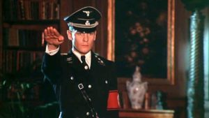 Martin (Helmut Berger)'s madness reaches its inevitable endpoint: as a dedicated SS officer serving the Reich in Luchino Visconti's The Damned (1969)