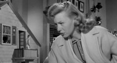 Louise (Randy Stuart) does her best to accommodate the awkward situation in The Incredible Shrinking Man (1957)