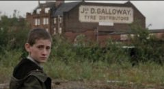 James (William Eadie) watches the world with suspicion in Lynne Ramsay's Ratcatcher (1999)